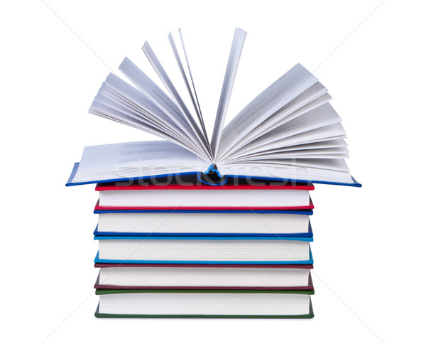 Open book on stack of books isolated. Stock photo © borysshevchuk