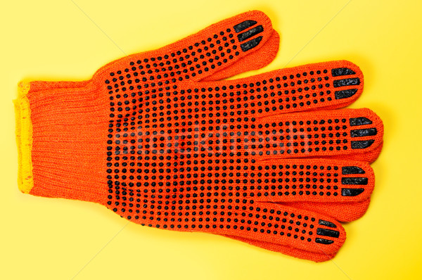 Working gloves isolated on yellow background. Stock photo © borysshevchuk