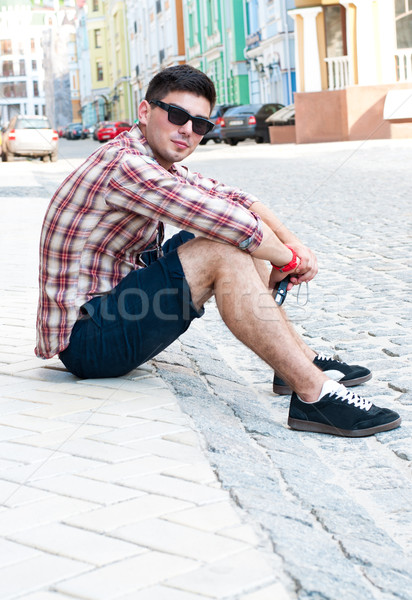 Guy sitting on the sidelines. Stock photo © borysshevchuk