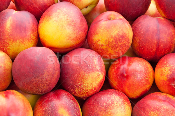 Ripe, bright peach close up. Stock photo © borysshevchuk