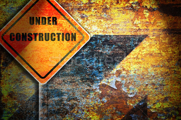 Roadsign under construction rusty wall. Stock photo © borysshevchuk