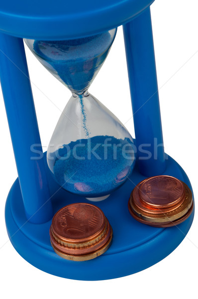 Sand-glass with coins. The top view. Stock photo © borysshevchuk