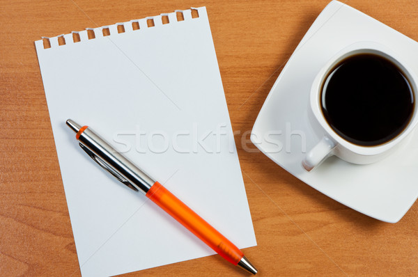 Worksheet with pen and coffee on table. Stock photo © borysshevchuk