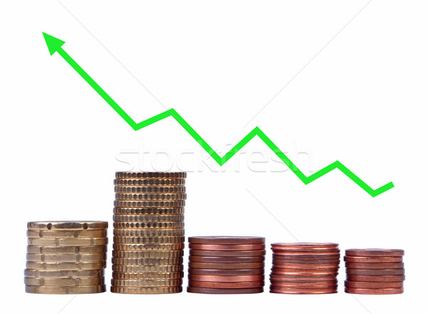 Stacks of coins with the arrow isolated. Stock photo © borysshevchuk