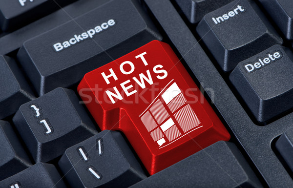 Hot news red button computer keyboard. Stock photo © borysshevchuk