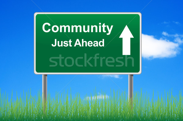 Community road sign on sky background, grass underneath. Stock photo © borysshevchuk