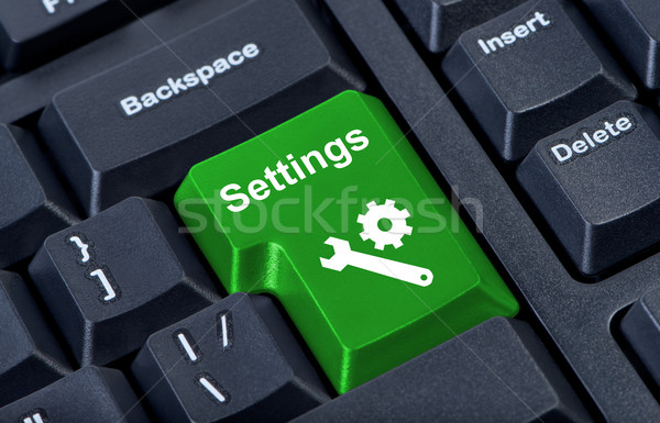 Button keypad settings with wrench and gear symbol. Stock photo © borysshevchuk
