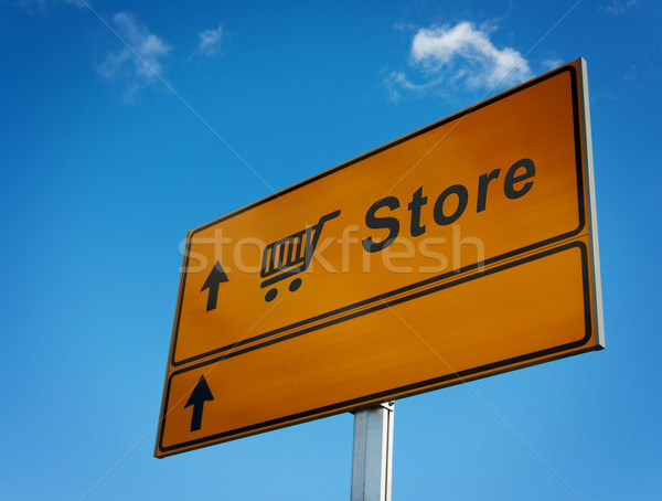 Store road sign with icon trolley. Stock photo © borysshevchuk