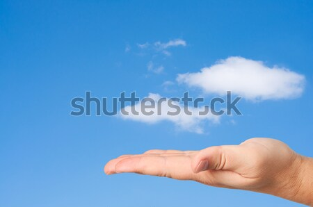 Hand in sky clouds background. Stock photo © borysshevchuk