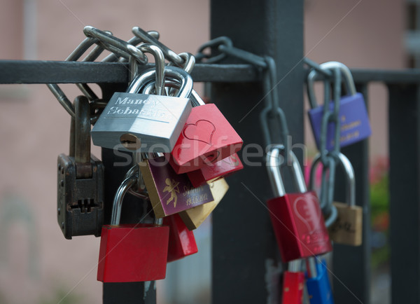 Padlocks chain fastened to the bridge. Stock photo © borysshevchuk