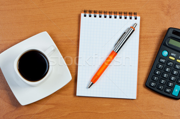 Coffee, notebook and pen on table. Stock photo © borysshevchuk