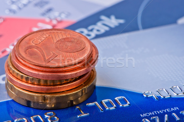 Heap of coins of eurocents and credit cards. Stock photo © borysshevchuk