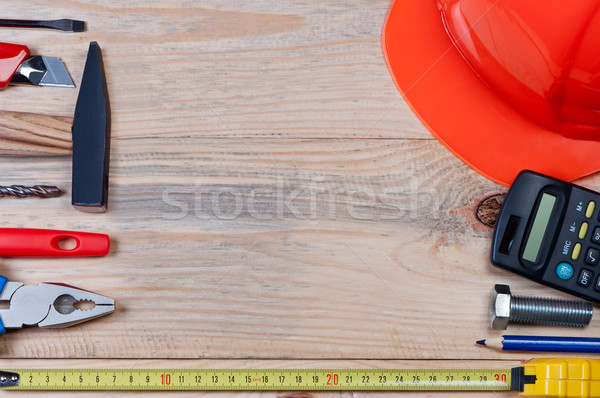 Set of construction tools on wooden board. Stock photo © borysshevchuk