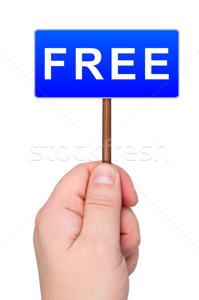 Road sign holds in hand with word FREE. Stock photo © borysshevchuk