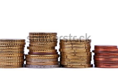 Stacks of coins isolated on white background. Stock photo © borysshevchuk