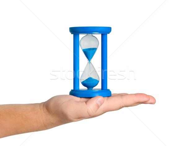 Hourglass on palm isolated white background. Stock photo © borysshevchuk