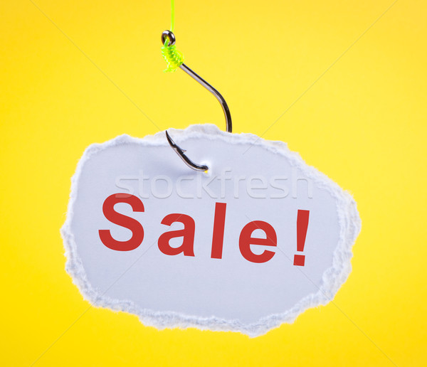 Sale! Scrap of paper on fishing hook. Stock photo © borysshevchuk