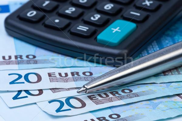 Money, calculator and a pen close-up. Stock photo © borysshevchuk