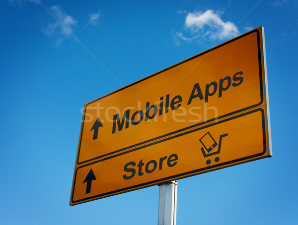 Mobile apps road sign with cart and smartphone. Stock photo © borysshevchuk