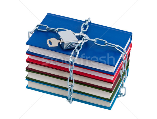 Stock photo: Books chained and closed padlock isolated over white.