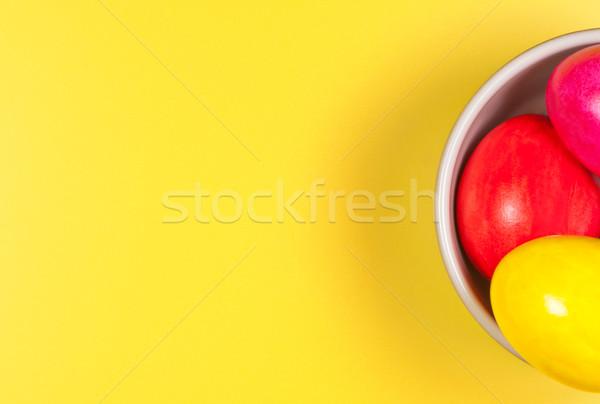 Huevos de Pascua tazón amarillo lugar texto Pascua Foto stock © borysshevchuk