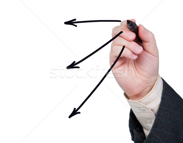 Hand with felt-tip pen drawing arrows. Stock photo © borysshevchuk