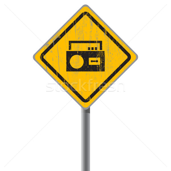 Stock photo: Old shabby yellow sign with an old-fashioned cassette recorder.