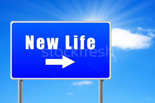 New life road sign with arrow on sky background. Stock photo © borysshevchuk
