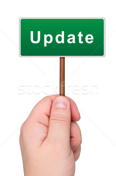 Update a road sign in hand. Stock photo © borysshevchuk