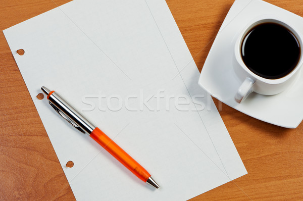 Torn sheet, pen and coffee on table, view from above. Stock photo © borysshevchuk