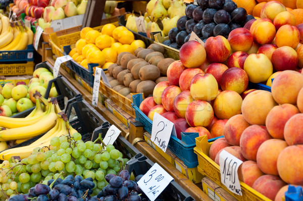 Fruit at market with price tags for sale. Stock photo © borysshevchuk