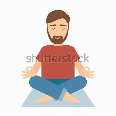 Businessman meditating in lotus pose. Stock photo © borysshevchuk