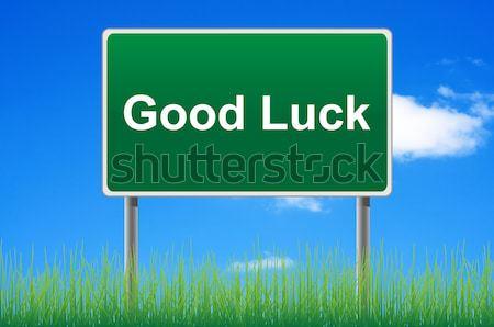 Good luck road sign on sky background. Bottom grass. Stock photo © borysshevchuk