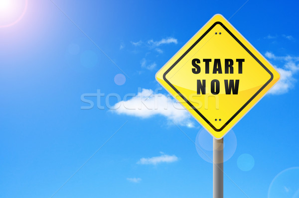 Signpost start now on sky background. Stock photo © borysshevchuk