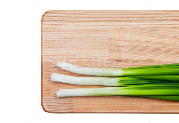 Green onions on cutting board. Stock photo © borysshevchuk
