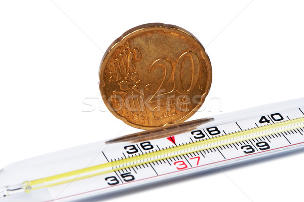 Medical thermometer with euro cent coin. Stock photo © borysshevchuk