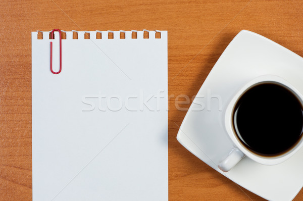 Torn sheet of paper and cup coffee on table. Stock photo © borysshevchuk