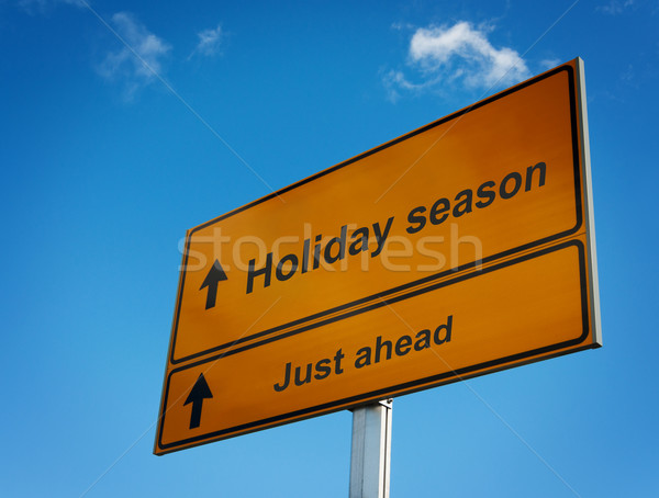 Holiday season road sign background sky. Stock photo © borysshevchuk