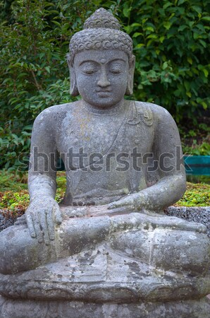 Stone Buddha in the lotus position. Stock photo © borysshevchuk