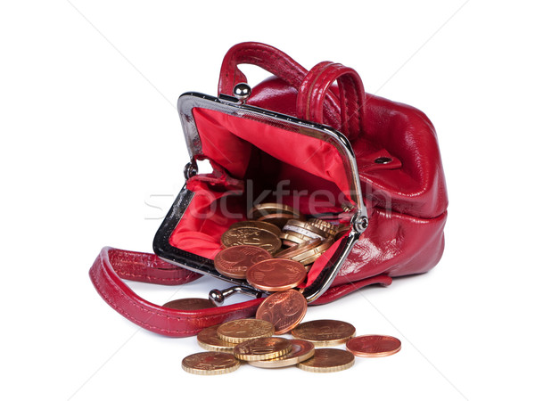 Coins in woman's purse on white background. Stock photo © borysshevchuk