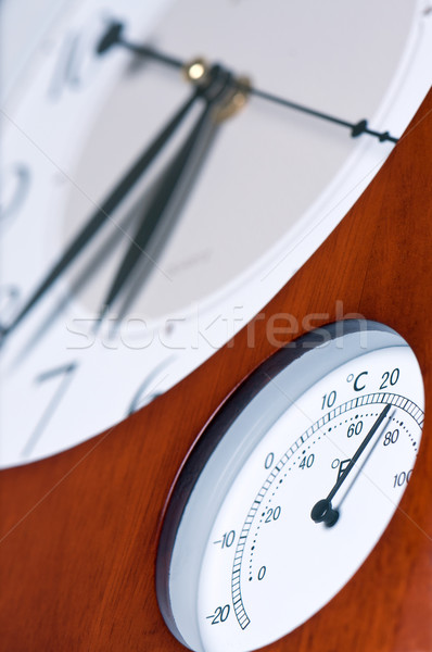 Clock and thermometer. Stock photo © borysshevchuk