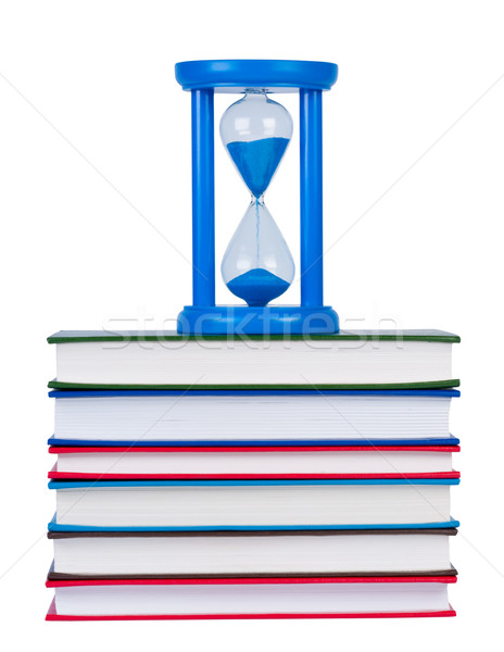 Hourglass on pile of books isolated on white background. Stock photo © borysshevchuk