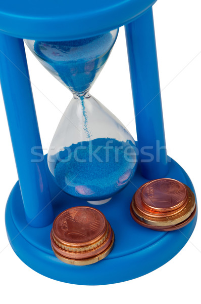 Sand-glass with coins top view isolated. Stock photo © borysshevchuk