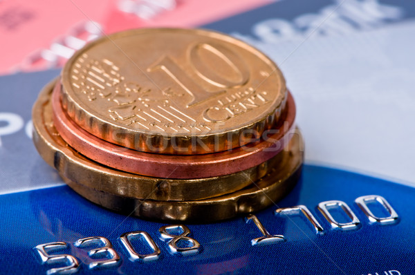Credit cards and coins heap. Stock photo © borysshevchuk