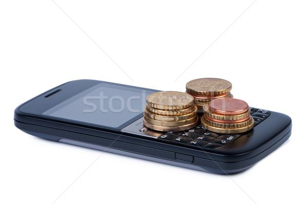 Stockfoto: Mobiele · telefoon · munten · betaling · spaargeld · witte · schaduw