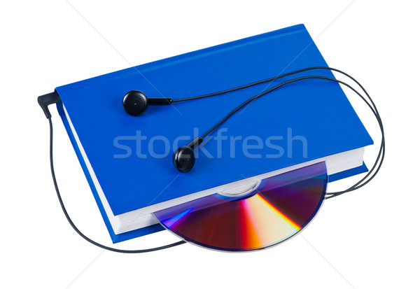Book with headphones and cd isolated on white background. Stock photo © borysshevchuk