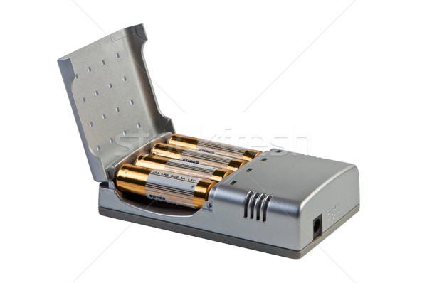Charger for accumulators isolated on white. Stock photo © borysshevchuk