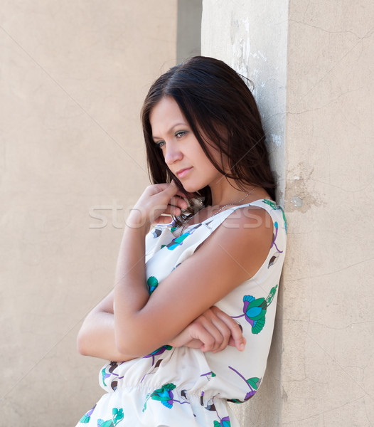 Girl leaned against the wall. Stock photo © borysshevchuk