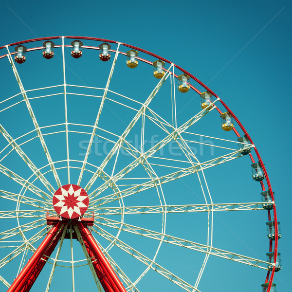 Ferris wheel attraction on blue sky background. Stock photo © borysshevchuk