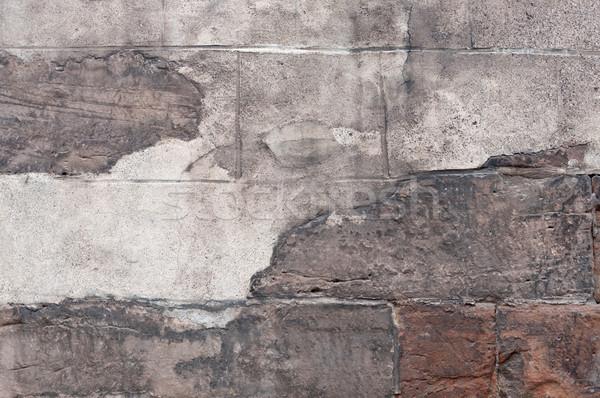 Old stone wall with peeling plaster. Stock photo © borysshevchuk